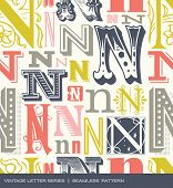 stock photo of letter n  - Seamless vintage pattern of the letter N in retro colors - JPG