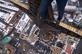 picture of legs apart  - Legs of man on star of residential building on Kudrinskaya Square in Moscow - JPG