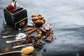 foto of chocolate spoon  - Sweet spices in the spoons and chocolate on a table black - JPG