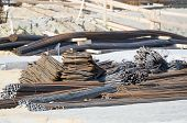 stock photo of reinforcing  - Steel Reinforcing Bars Stack at Construction Area - JPG