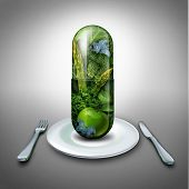 foto of fruit  - Food supplement concept as a giant pill or medicine capsule with fresh fruit and vegetables inside on a table place setting as a nutrition and dietary symbol for good eating health and fitness lifestyle - JPG