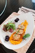 image of patty-cake  - White meat patty cakes with pumpkin mash on restaurant table - JPG
