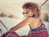 pic of funky  - Portrait of beautiful happy woman with stylish hairdo having fun on sailboat - JPG