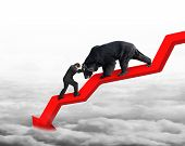picture of stop fighting  - Businessman against black bear on red arrow downward trend line with gray cloudscape background - JPG
