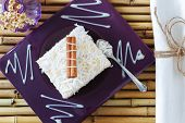 foto of condensation  - Rice pudding with coconut condensed milk and cinnamon on purple plate - JPG