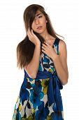 stock photo of petition  - Beautiful petite Eurasian woman in a blue and yellow print dress - JPG