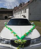 stock photo of limousine  - White wedding limousine in the yard of fortress Narva Estonia  - JPG