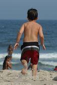 Boy Running To Ocean