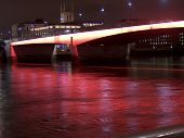 A Bridge By Night, Illuminated With The Red Lighting