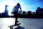 picture of skateboarding  - woman skateboarder legs skateboarding at sunrise city - JPG