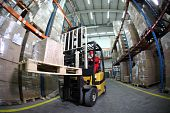 forklift driver at work in warehouse