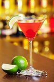 stock photo of cosmopolitan  - Cosmopolitan cocktail shot on a bar counter - JPG