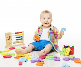 stock photo of child development  - Baby Playing Education Toys Kid Play Alphabet Letters Numbers Logic Toy Little Child Early Development Concept - JPG