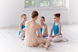 picture of  dancer  - Three little ballerinas with personal ballet teacher in dance studio - JPG