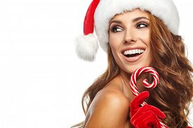 stock photo of lollipops  - Beautiful woman with santa hat holding red  - JPG
