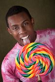 Man Licks Giant Candy Sucker