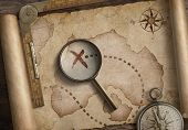 vintage nautical compass and loupe on table with old treasure map scroll 3d illustration poster