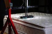 pic of mater  - Mattress testing in mattress factory with copy space - JPG