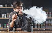 Vape Bar (shop). Vaping Man Is Smoking E-cigarette. A Cloud Of Vapor. poster