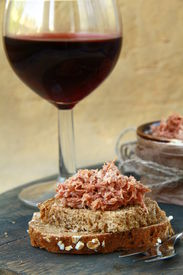 foto of canard  - pate of duck meat Rillettes de Canard  with a glass of wine - JPG