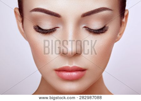 poster of Beautiful Woman With Extreme Long False Eyelashes. Eyelash Extensions. Makeup, Cosmetics. Beauty, Sk