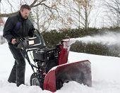 Man Operating Snow Blower
