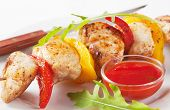 Chicken skewer with ketchup