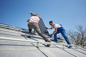 Male Workers Installing Stand-alone Solar Photovoltaic Panel System. Electricians Mounting Blue Sola poster