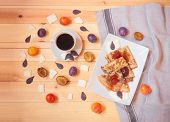 Cup Of Coffee, Homemade Pancakes With Homemade Plum Jam, Fresh Plums And Chocolate Chips On Wooden T poster