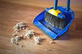 Dust On A House Floor And Floor Brush With Dustpan Background. Home Cleaning Concept. poster