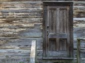 Closed Front Door. Weathered Wood Home With Closed Front Door And Old Lock. poster
