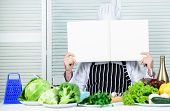 Man Chef In Hat And Apron Read Book. Culinary Recipes Book Concept. Improve Cooking Skill. Useful Bo poster
