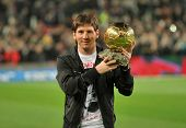 BARCELONA, SPAIN - DEC 12: Messi holds up his Golden ball, before the Spanish league match between B