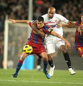 BARCELONA - OCT 30: Busquets(L) of Barcelona fight with Kanoute(R) of Sevilla during spanish league