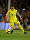 BARCELONA - NOV 13: Cazorla of Villarreal CF in action during a Spanish League match between FC Barcelona and Villarreal CF at the Nou Camp Stadium on November 13, 2010 in Barcelona, Spain