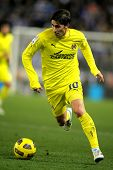 BARCELONA - JAN 30: Cani of Villareal goes after the ball during a Spanish League match between Espa