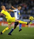 BARCELONA - JAN 30: Borja Valero of Villareal(L) with Luis Garcia(R) of Espanyol compete during a ma