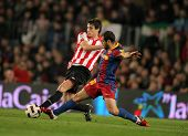 BARCELONA - FEB 20: Javi Martinez(L) of  Bilbao fight with Mascherano(R) of Barcelona during  the ma