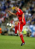 BARCELONA - AUG 2: Jamie Carragher of Liverpool FC in action during a friendly match against RCD Espanyol at the Estadi Cornella-El Prat on August 2, 2009 in Barcelona, Spain