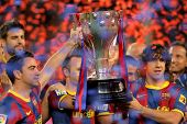 BARCELONA - MAY 15: Xavi and Carles Puyol of FC Barcelona hold the La Liga trophy after the match be