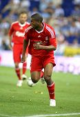 BARCELONA - AUGUST 2: Ryan Babel, Dutch player of Liverpool FC, in action during a friendly match against RCD Espanyol at the Estadi Cornella-El Prat on August 2, 2009 in Barcelona, Spain.