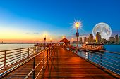 Scenic Twiligtht View Of Coronado Wooden Pier With Docked Ferry Boat On Coronado Island, California, poster