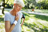 Senior Woman With Chest Pain Suffering From Heart Attack During Jogging poster
