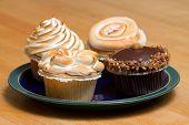 Four fancy cupcakes