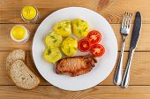 Boiled Yellow Potatoes With Tomatoes, Piece Of Fried Carbonnade In White Plate, Knife, Fork, Pieces  poster