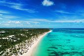 Aerial View Of Punta Cana Beach Resort, Dominican Republic. Summer Holiday With Parasailing, Diving, poster