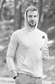 Refreshing Vitamin Drink After Great Workout. Man Athletic Appearance Holds Water Bottle. Athlete Dr poster