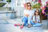 Fashion Family Concept - Stylish Mother And Child Wear. A Portrait Of A Happy Family: A Young Beauti poster