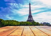 Empty Surface Of A Wooden Table On A Background Of Eifel Tower In Paris, France. Free Place. poster