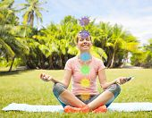 fitness, yoga and healthy lifestyle concept - happy woman meditating in summer park with seven chakr poster